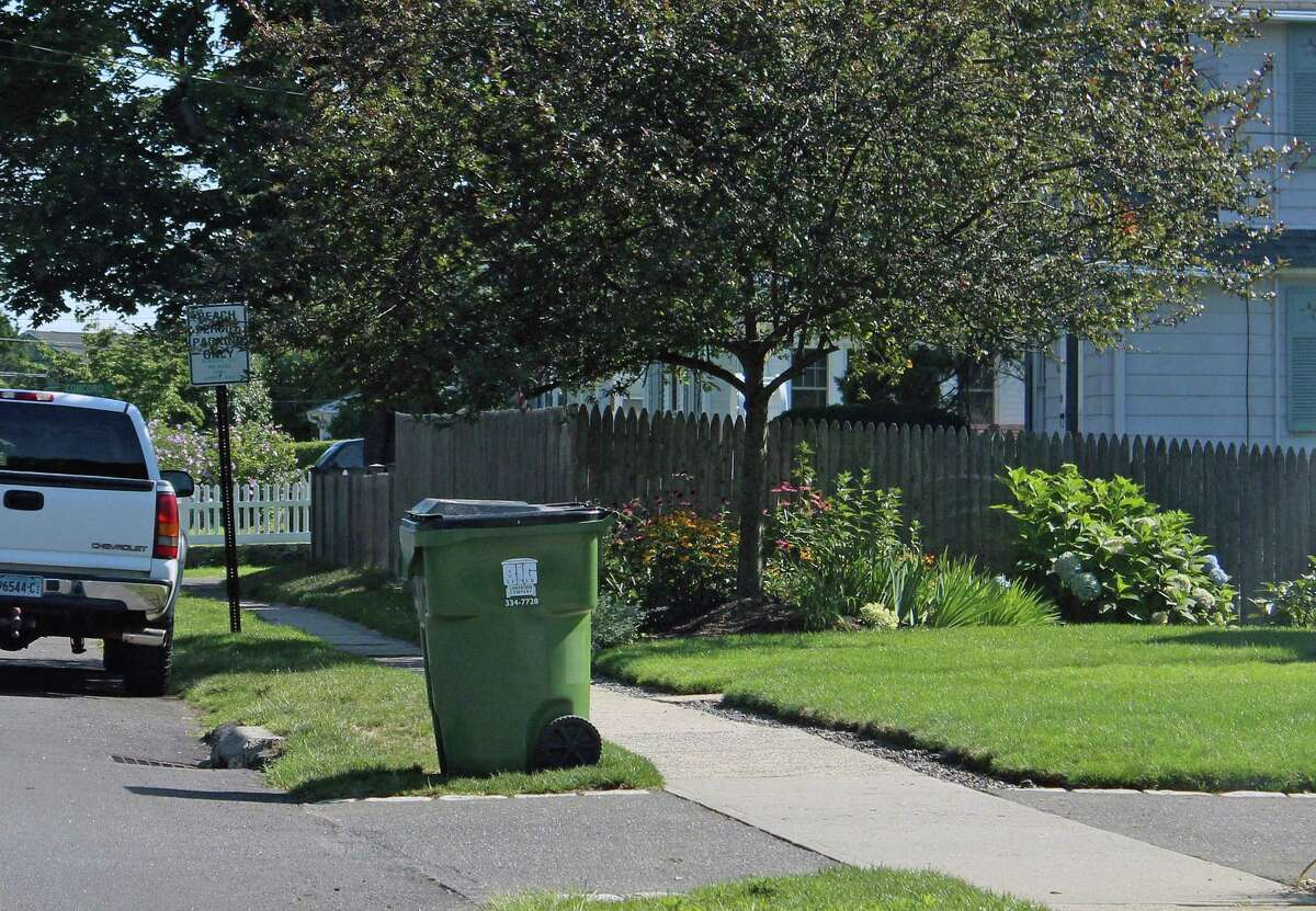 Trash cans brought to the curb to await collection are against town regulations. Curbside collection is only allowed for residential recycling. Fairfield,CT. 8/9/17