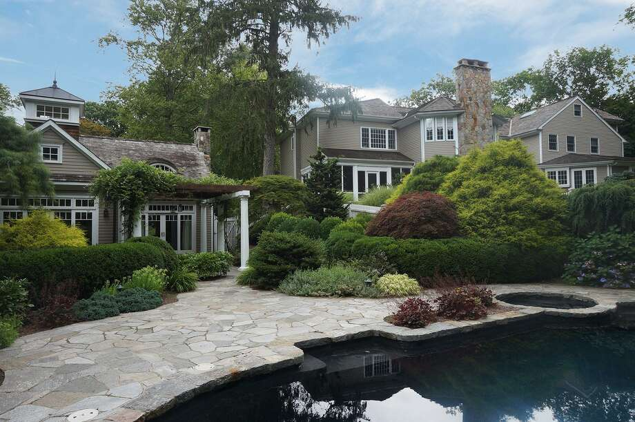 This 3.93-acre estate straddles two towns and has two separate addresses: 315 North Ave. in the Coleytown section of Westport and 17 North Ave. in lower Weston. The pool/guest house is in Weston and the main house is in both towns. Photo: /