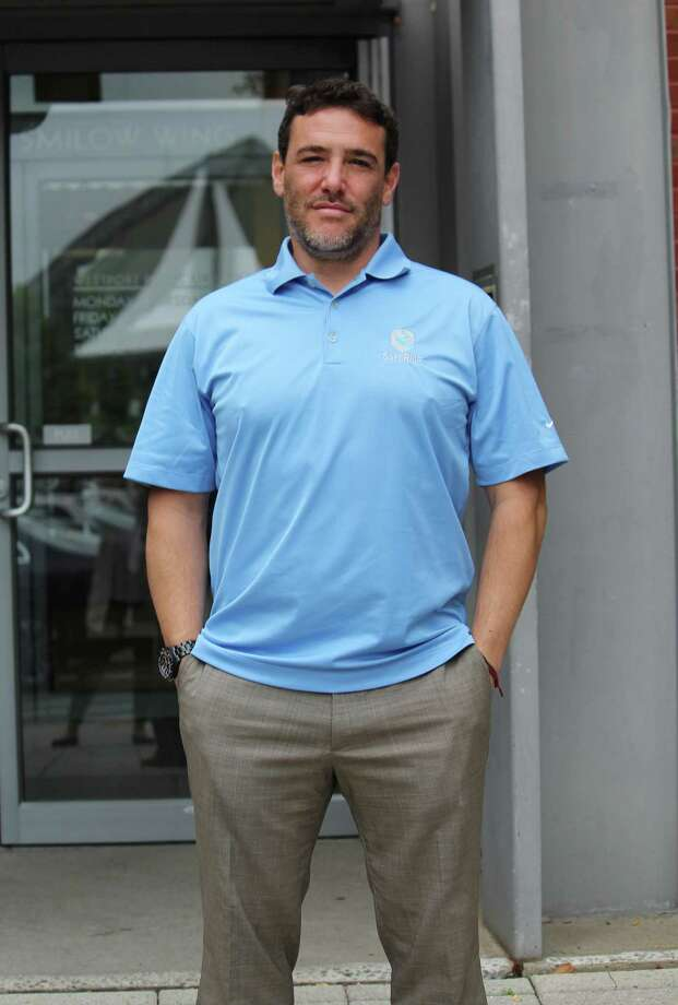 Scott Rownin, 41, of Westport, launched SafeRide last week. The mobile app aims to curb texting while driving by locking a cell phone's screen and muting alerts while its owner is driving. Photo: Laura Weiss / Hearst Connecticut Media / Westport News