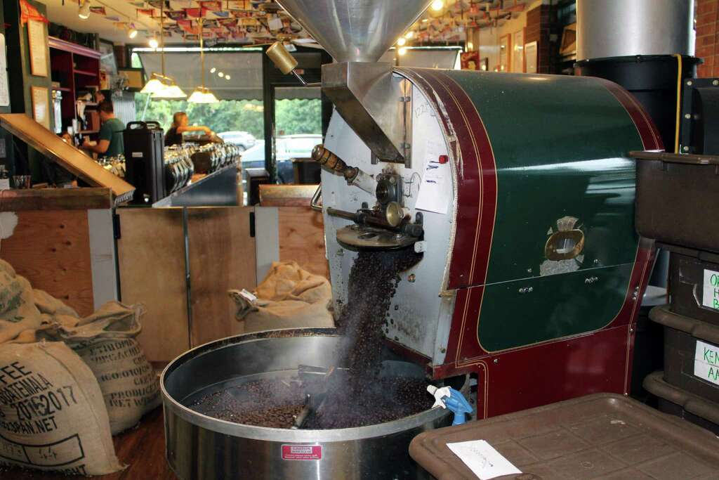 freshly roasted coffee beans move from the roaster to the cooling bin at gourmet coffee