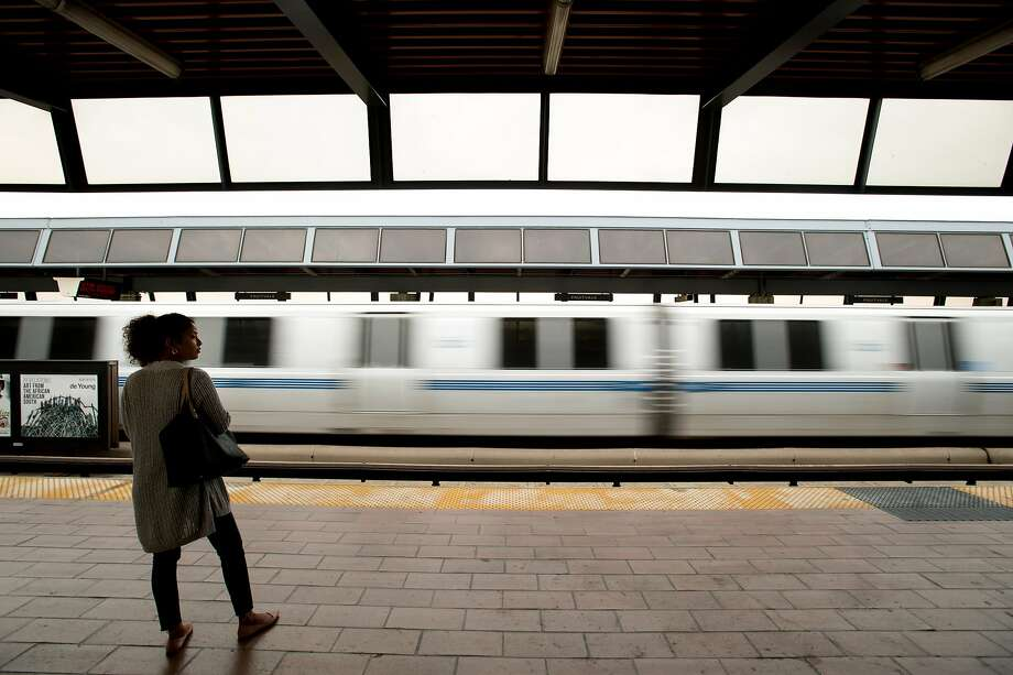 A BART rider waits for a train at the Fruitvale station on Friday, Aug. 4, 2017, in Oakland, Calif. Photo: Noah Berger, Special To The Chronicle