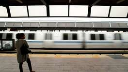 A BART rider waits for a train at the Fruitvale station on Friday, Aug. 4, 2017, in Oakland, Calif.
