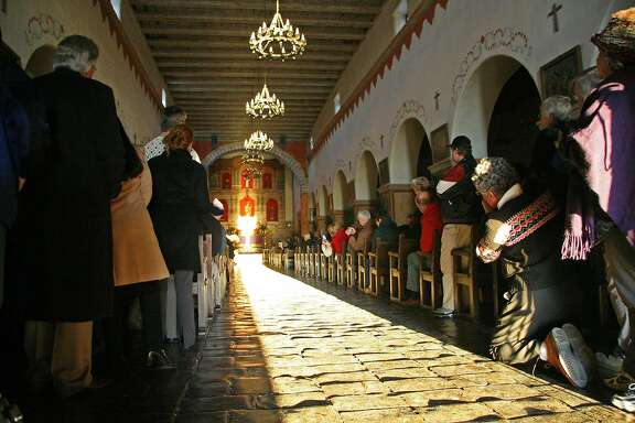 Visitors assemble to view the midwinter solstice at the mission in San Juan Bautista, Calif., on December 21, 2007.