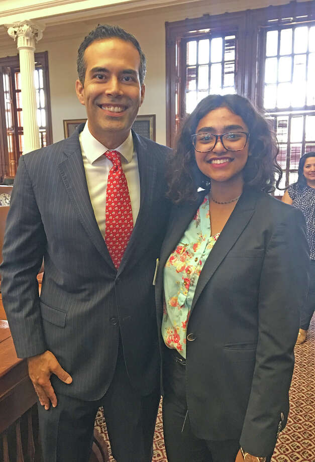 Cypress Ranch senior Nafisa Ahmed joins Texas Land Commissioner George P. Bush on the floor of the House of Representatives in the Texas Capitol building after discussing his work as land commissioner and the opportunities for young people to become involved in government. Photo: CFISD