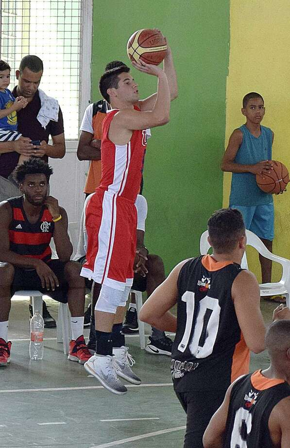 Wilton's Eric Houska, playing for Team USA, fires up a 3-point shot during one of his games in Brazil. Photo: Contributed Photo /
