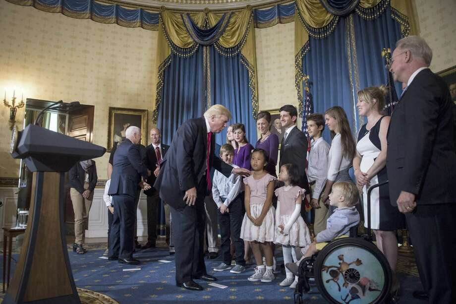 """President Donald Trump greets """"victims of Obamacare"""" after speaking at a White House event about health care in late July. The administration's rhetoric and efforts reflect its contradictory approach to the law's next enrollment season, which begins Nov. 1. Photo: Jabin Botsford /The Washington Post / The Washington Post"""
