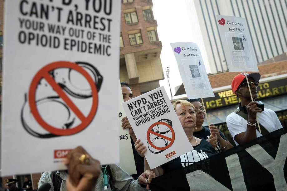 "Activists rally during a protest denouncing the city's ""inadequate and wrongheaded response"" to the overdose crisis, outside of the New York City Police Department headquarters, Thursday. They have a point. Treatment is a better option. Photo: Drew Angerer /Getty Images / 2017 Getty Images"