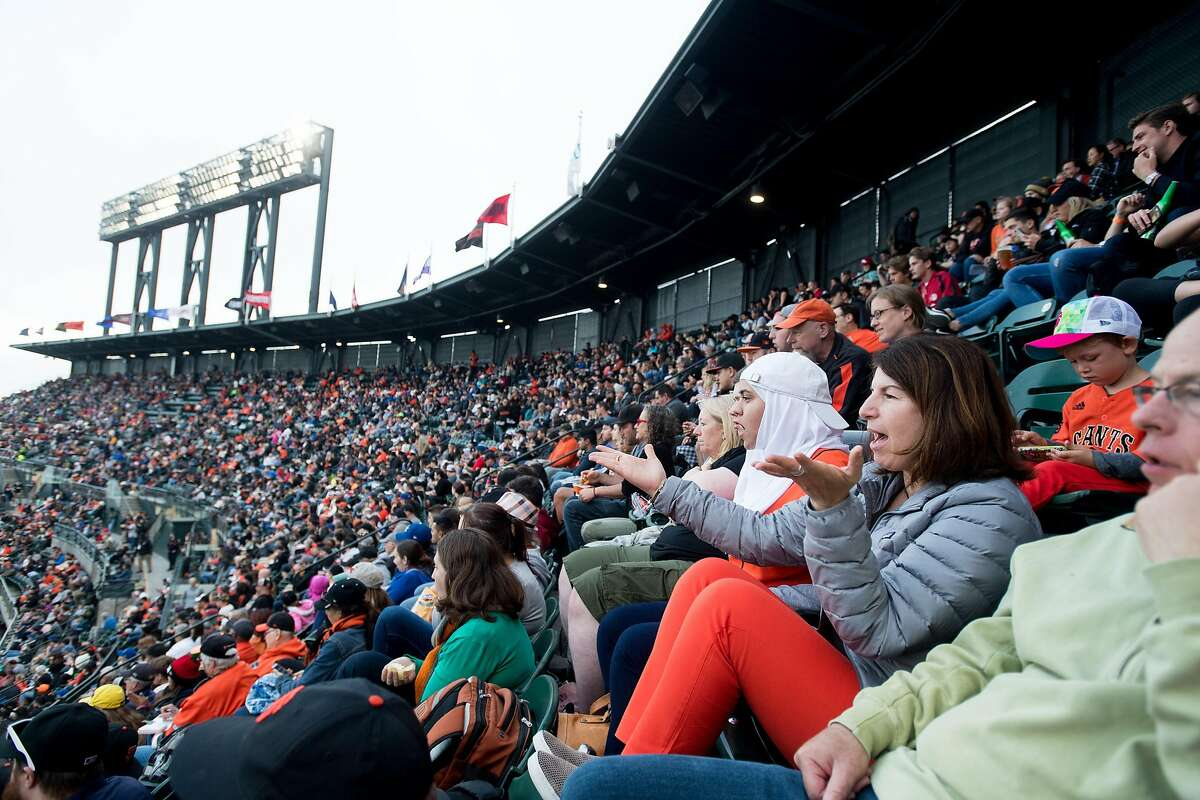 Samia Rashed, right, and her niece Samia Rashed react as the Giants play the Mets on Friday, June 23, 2017, in San Francisco.