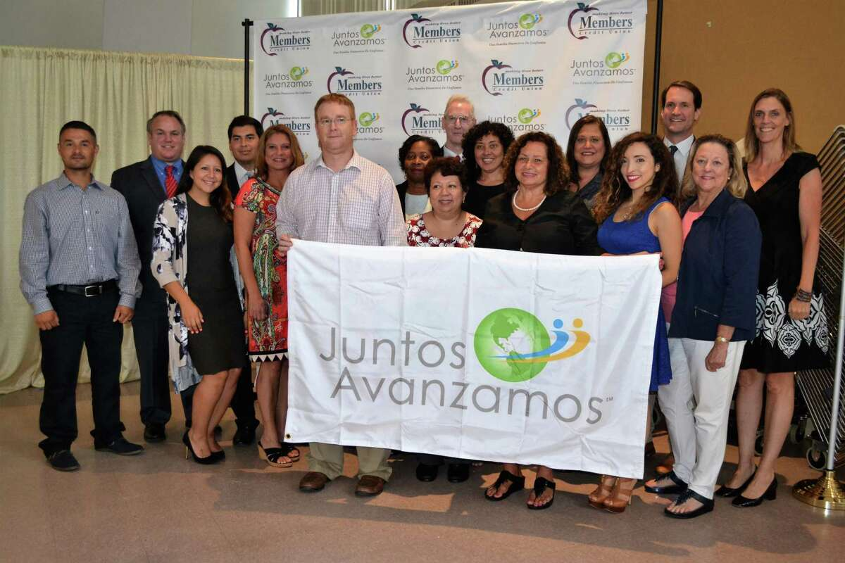 """Cos Cob's Members Credit Union was the first credit union in the state to be recognized as a """"Juntos Avanzamos"""" credit union last week - one which helps underserved Spanish-speaking and immigrant clients. Shown from left are Carlos Castro-Velez, Peter Yeskey, Lesley Ulloa, Harrinson Agudelo-Rios, Kelly Kortner, Brian Wood, Helen Charles, Evelyn Montufar, Michael Gavan, Elsa Soogrim, Kathy Chartier, Lynn Sabatino, Vanessa Kuduk, U.S. Rep. Jim Himes, Linda Shirley and Cathie Mahon."""