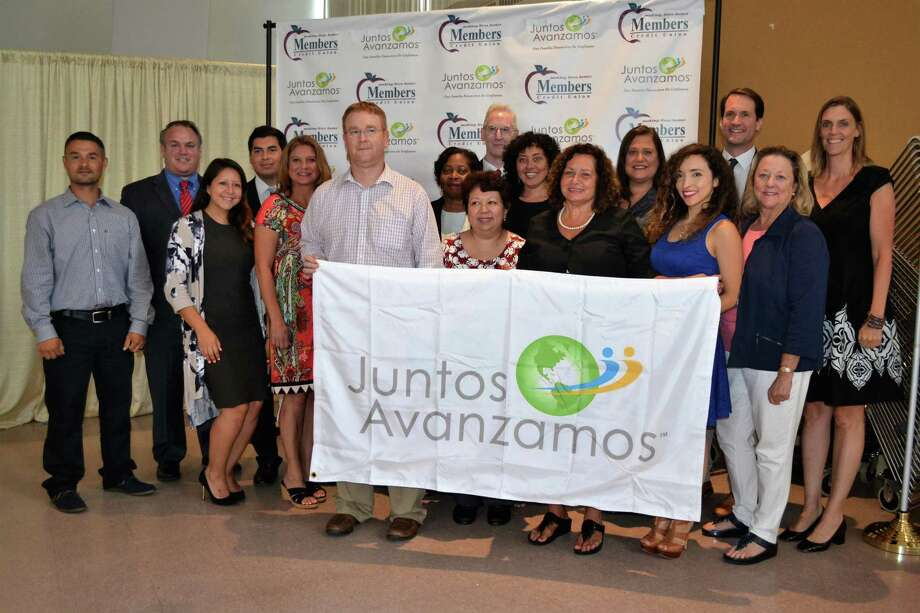 "Cos Cob's Members Credit Union was the first credit union in the state to be recognized as a ""Juntos Avanzamos"" credit union last week — one which helps underserved Spanish-speaking and immigrant clients. Shown from left are Carlos Castro-Velez, Peter Yeskey, Lesley Ulloa, Harrinson Agudelo-Rios, Kelly Kortner, Brian Wood, Helen Charles, Evelyn Montufar, Michael Gavan, Elsa Soogrim, Kathy Chartier, Lynn Sabatino, Vanessa Kuduk, U.S. Rep. Jim Himes, Linda Shirley and Cathie Mahon. Photo: Contributed / National Federation Of Community Development Credit Unions"
