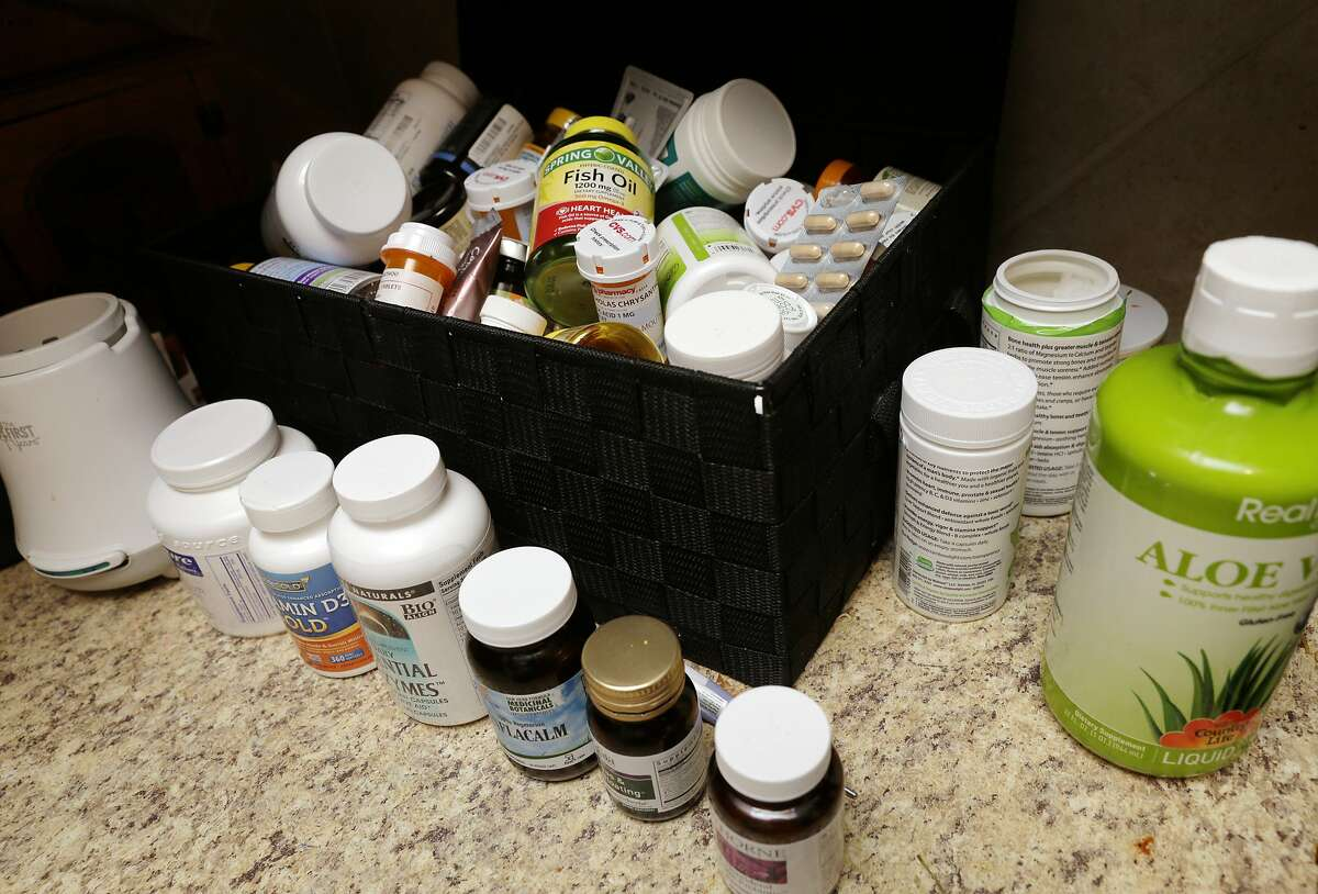 Some of the dietary supplements Nicholas Chrysanthou takes to deal with his over 80 food allergies, on the kitchen counter of his home in Houston, TX, June 28, 2017. (Michael Wyke / For the Chronicle)