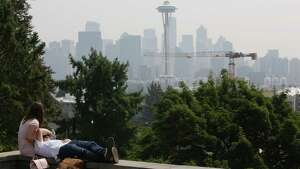 Haze from wild fires in British Columbia continues to hang over the Seattle skyline, Thursday, Aug. 10, 2017.