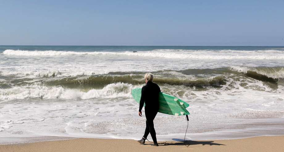 Mark Massara, an attorney representing the Surfrider Foundation, is ready to surf at Martins Beach near Half Moon Bay after a court ordered landowner Vinod Khosla to unlock a private gate and allow access. Photo: Paul Chinn, The Chronicle
