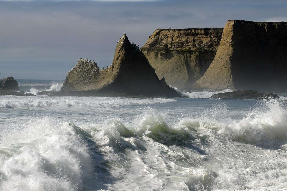 The surf breaks against the beach near the distinctive shark's tooth rock at Martin's Beach in San Mateo County, Calif., on Wednesday, September 24, 2014. A judge ruled on Wednesday, that property owner Vinod Khosla has to reopen the road that provides public access to the public beach.