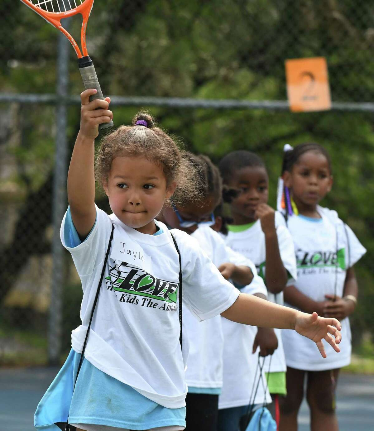 Jayla Ryan lines up a shot during a 15-Love tennis camp at Washington Park on Thursday, Aug. 10, 2017, in Albany, N.Y. The not-for-profit youth tennis program, which serves more than 1,900 inner-city children in the cities of Albany, Troy, Schenectady and Rensselaer throughout the summer, held its 28th annual summer Jamboree. (Will Waldron/Times Union)