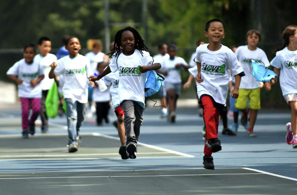 Children take part in a warmup exercise during a 15-Love tennis camp at Washington Park on Thursday, Aug. 10, 2017, in Albany, N.Y. The not-for-profit youth tennis program, which serves more than 1,900 inner-city children in the cities of Albany, Troy, Schenectady and Rensselaer throughout the summer, held its 28th annual summer Jamboree. (Will Waldron/Times Union)