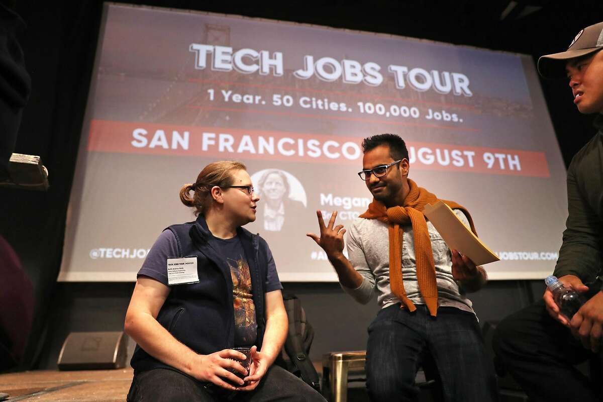 Beth Andres-Beck, Long-Term Stock Exchange senior software engineer, (left) chats with Daksh Sharma during Tech Jobs Tour at Grand Theater in San Francisco, Calif. on Wednesday, August 9, 2017.