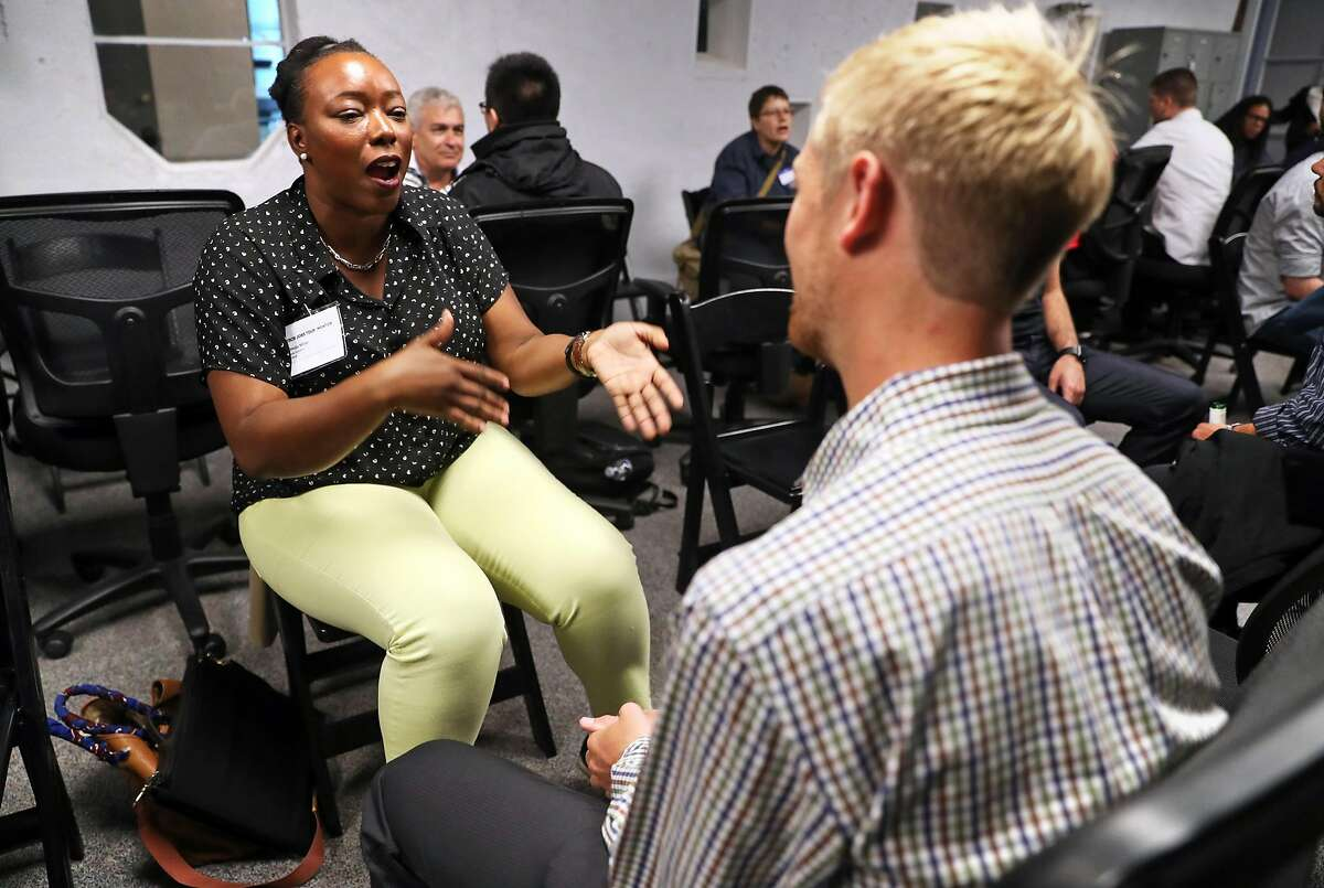 Omoju Miller, Github data scientist, talks with Liam Weaver during speed mentoring session at Tech Jobs Tour at Grand Theater in San Francisco, Calif. on Wednesday, August 9, 2017.