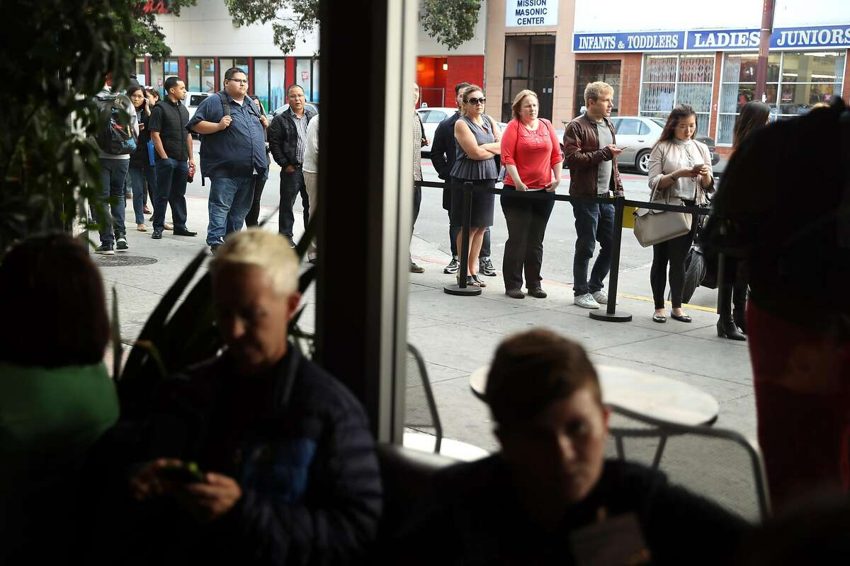 People wait in line outside Tech Jobs Tour at Grand Theater in San Francisco, Calif. on Wednesday, August 9, 2017.