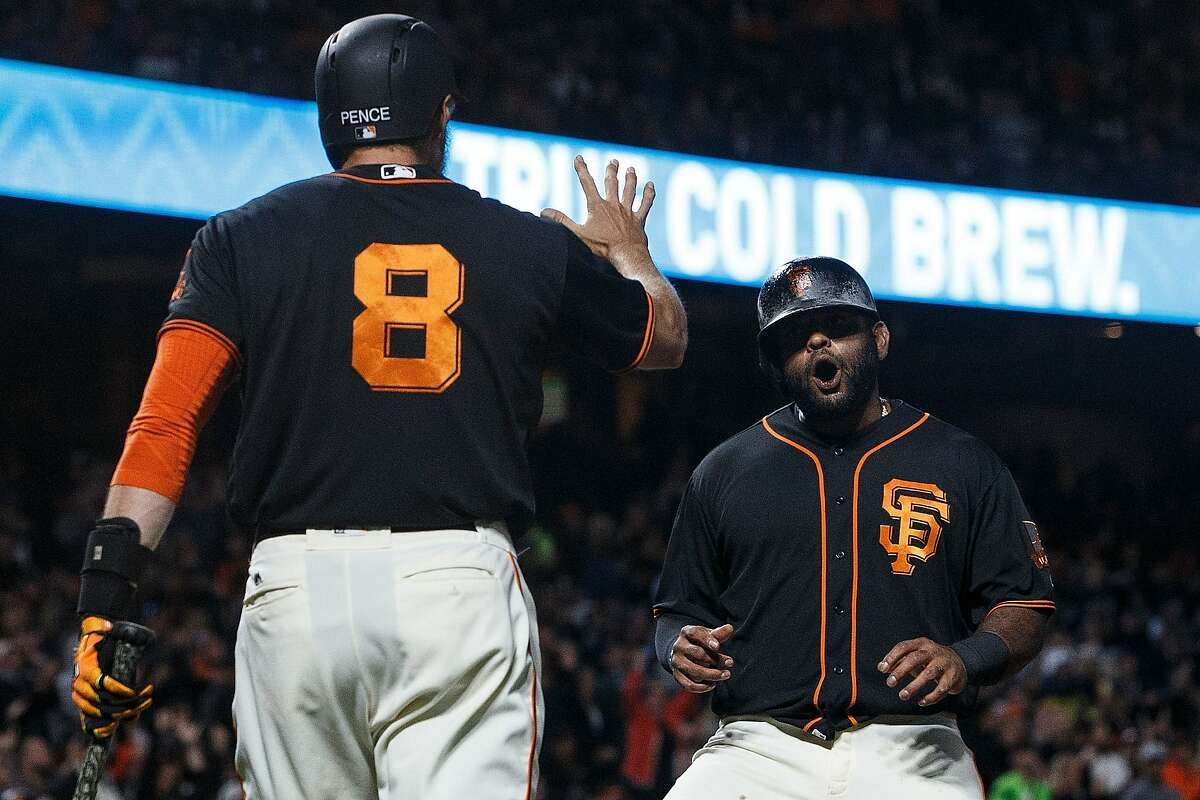 SAN FRANCISCO, CA - AUGUST 05: Pablo Sandoval #48 of the San Francisco Giants is congratulated by Hunter Pence #8 after scoring a run against the Arizona Diamondbacks during the seventh inning at AT&T Park on August 5, 2017 in San Francisco, California. The San Francisco Giants defeated the Arizona Diamondbacks 5-4 in 10 innings. (Photo by Jason O. Watson/Getty Images)