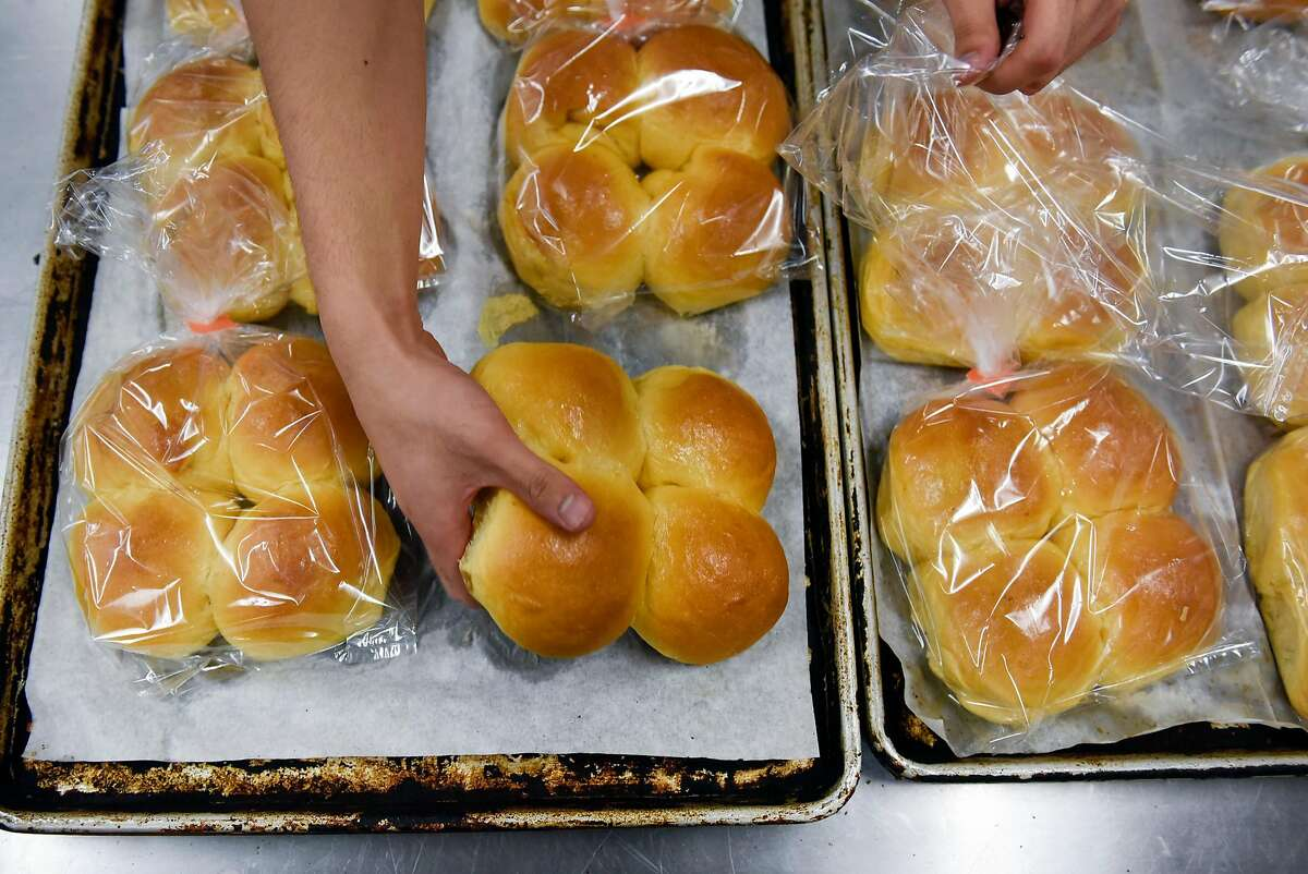 Worker Allen Lagman packages up coconut bread at Elite Bakery in Union City, CA, on Thursday August 10, 2017.