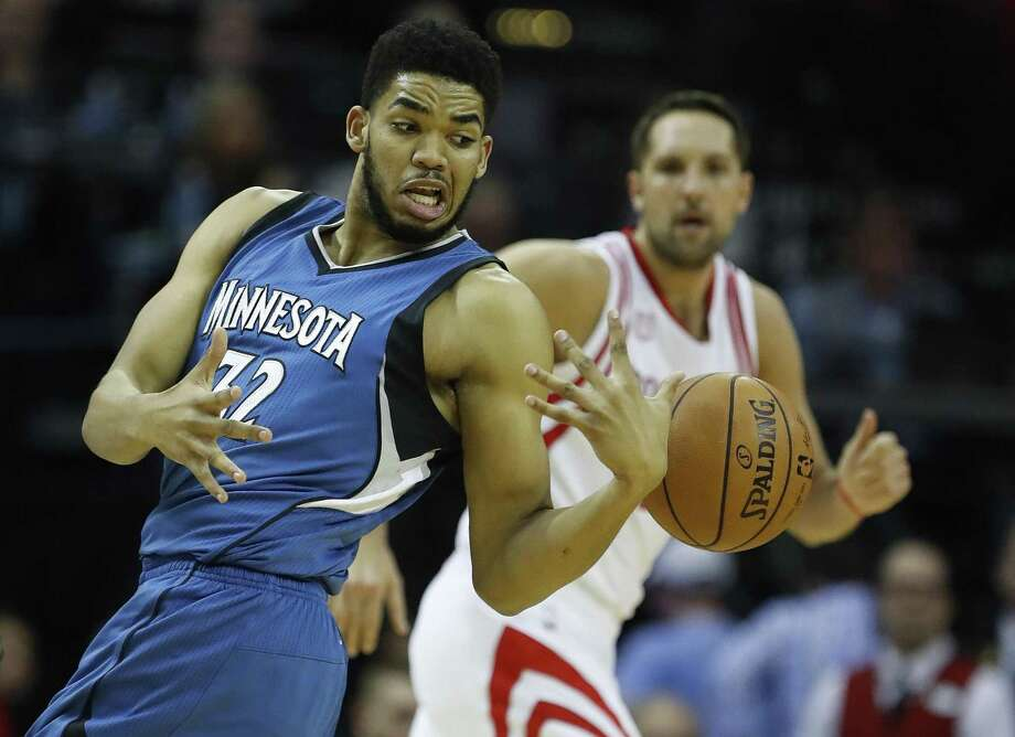 Minnesota Timberwolves center Karl-Anthony Towns tries to hang onto the ball during the first half at the Toyota Center on April 12, 2017, in Houston. Photo: Karen Warren /Houston Chronicle / 2017 Houston Chronicle