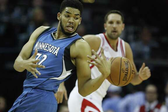 Minnesota Timberwolves center Karl-Anthony Towns tries to hang onto the ball during the first half at the Toyota Center on April 12, 2017, in Houston.