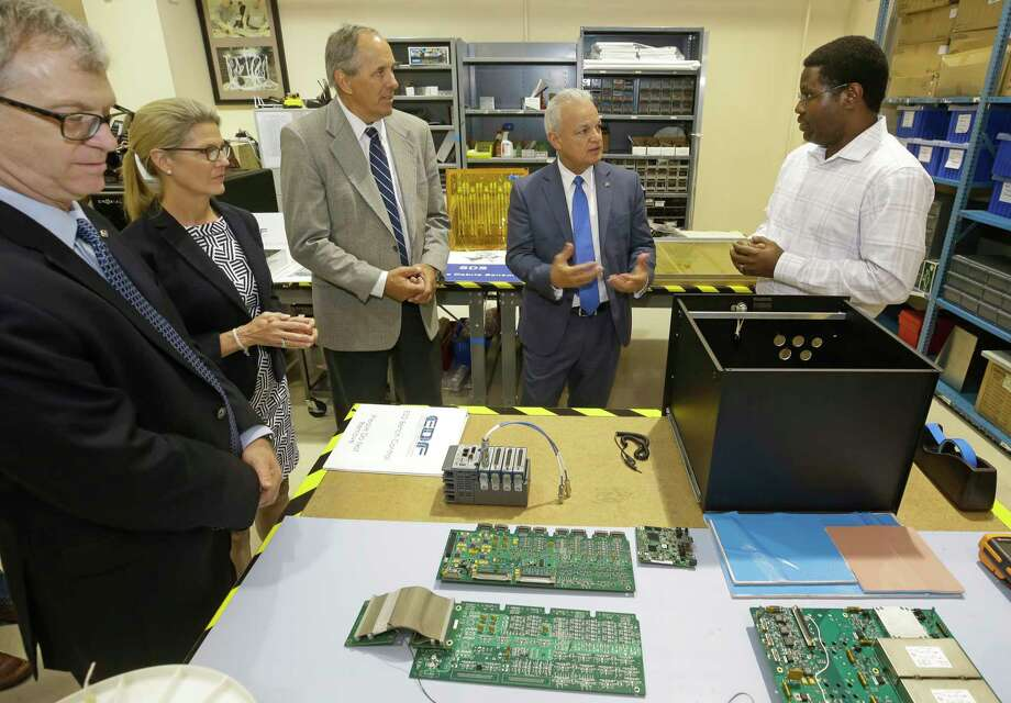 Chris Culbert, Johnson Space Center chief technologist, left, Joy Kelly, deputy general manager of the Jacobs Clear Lake Group, Lon Miller, general manager of the Jacobs Clear Lake Group, and Douglas Terrier, NASA acting chief technologist, talk with Kwaku Nornoo, electrical system chief engineer at Jacobs, right, about space debris sensors during a tour at Jacobs, 2224 Bay Area Boulevard, Thursday, Aug. 10, 2017, in Houston. ( Melissa Phillip / Houston Chronicle ) Photo: Melissa Phillip, Staff / © 2017 Houston Chronicle