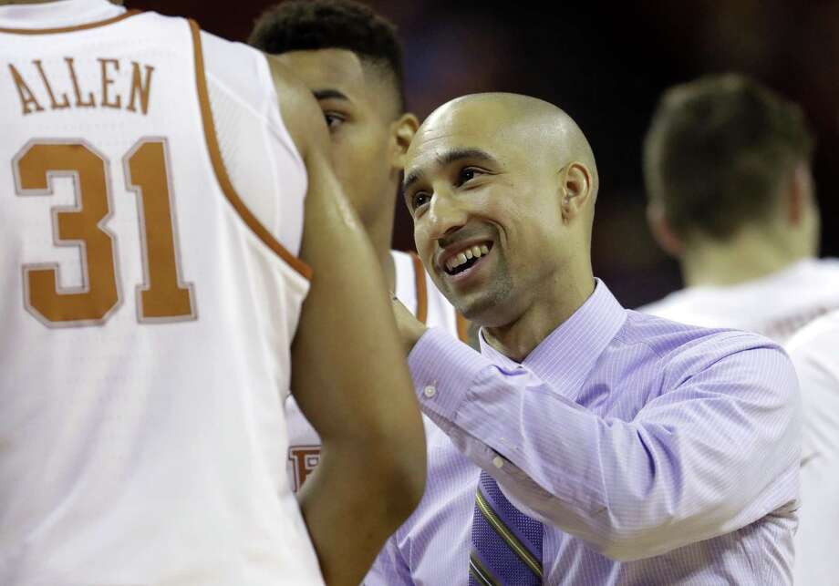 Texas coach Shaka Smart talks with his players during a timeout in the first half against Eastern Washington on Nov. 17, 2016, in Austin. Photo: Eric Gay /Associated Press / Copyright 2016 The Associated Press. All rights reserved.