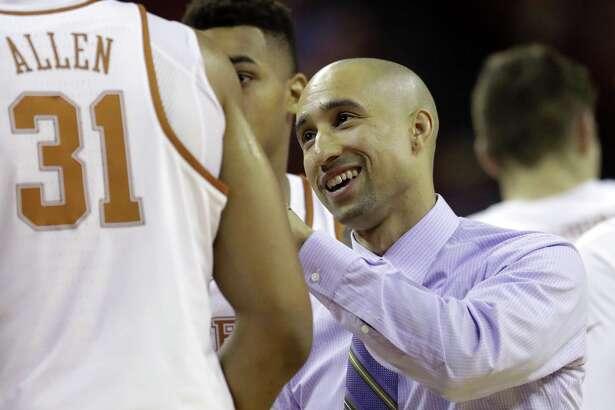 Texas coach Shaka Smart talks with his players during a timeout in the first half against Eastern Washington on Nov. 17, 2016, in Austin.