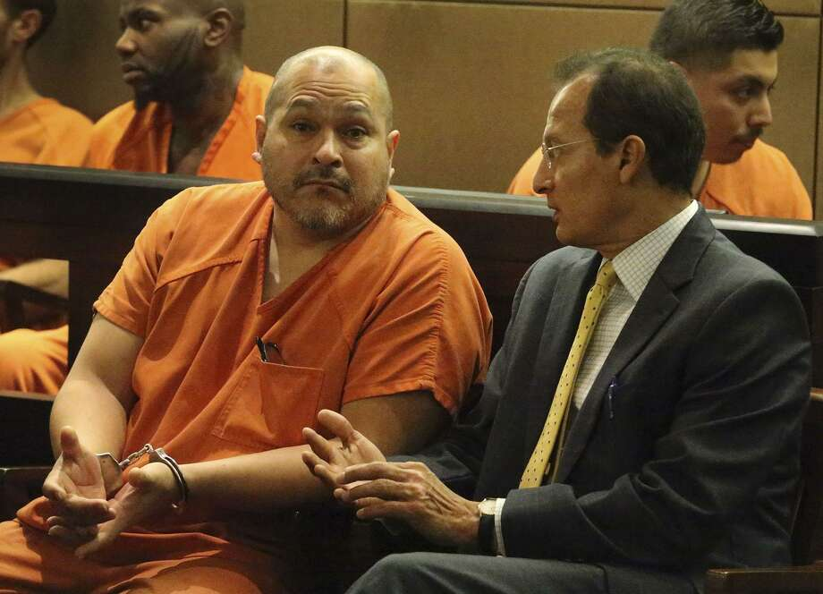 Defendant Richard Sanchez,49, (left) speaks with Roger Perez (right) Thursday August 10, 2017 in the 290th Criminal District Court. Sanchez has been sentenced to 30 years in prison for intoxication manslaughter and intoxication assault. Sanchez was arrested on a warrant for intoxication manslaughter in the death of 18-year-old Miguel Hernandez after driving the wrong way on IH-35 last January. He was also booked on three charges of intoxication assault. Investigators had estimated that 10 people were taken to nearby hospitals, and several were critically injured. Photo: John Davenport, STAFF / San Antonio Express-News / Sanchez