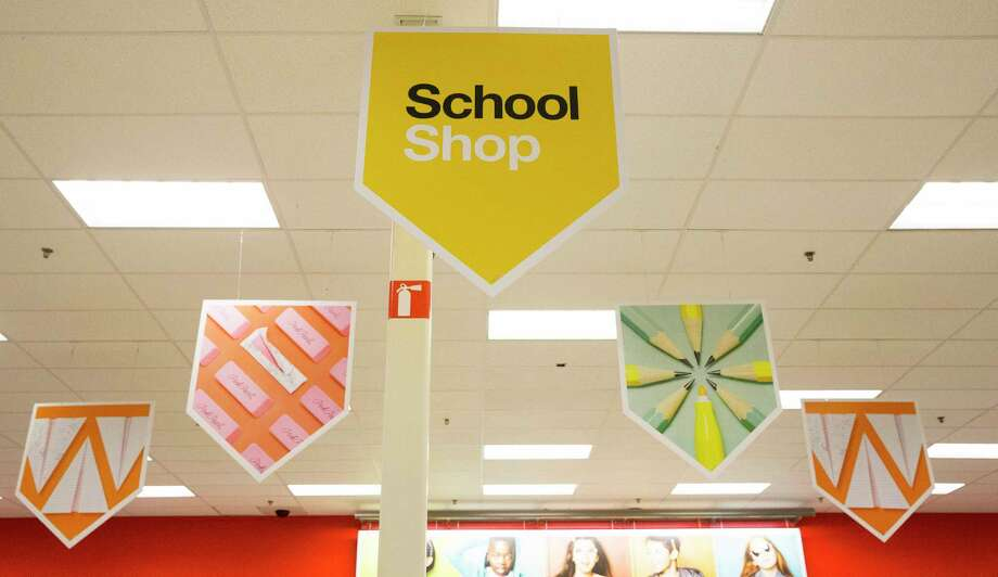 Sings directing guests to the school supply area are hung from the ceiling at a Target store Thursday, Aug. 10, 2017, in Houston. ( Yi-Chin Lee / Houston Chronicle ) Photo: Yi-Chin Lee, Staff / © 2017  Houston Chronicle
