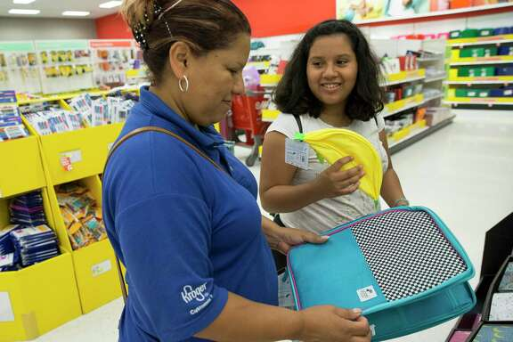 Alondra Martinez, 12, shows a banana pencil pouch to her mother, Rosaria, while checking out school supplies at a Target store Thursday, Aug. 10, 2017, in Houston. Alondra is going to be a seventh-grader this year. ( Yi-Chin Lee / Houston Chronicle )