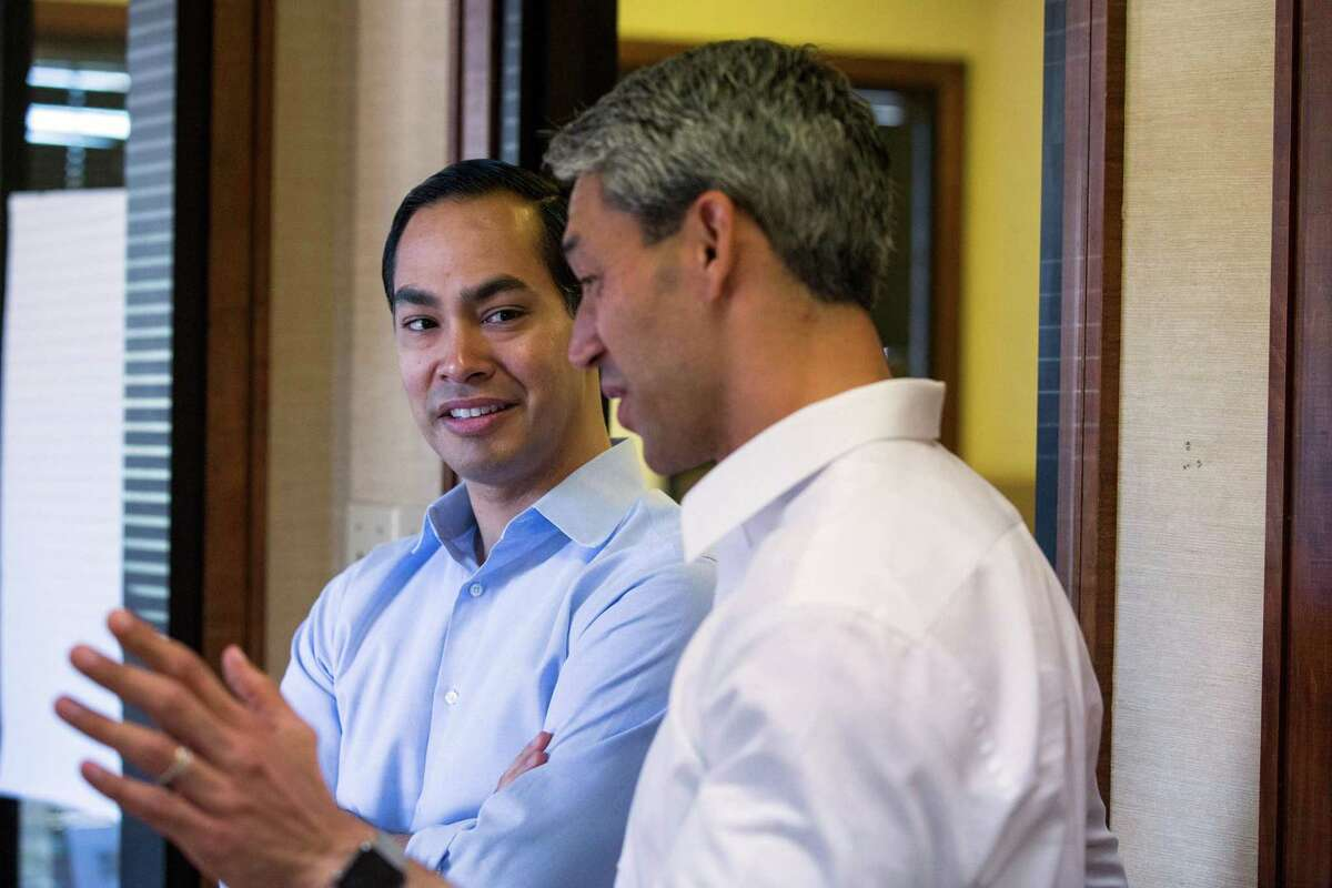 Mayoral candidate Ron Nirenberg speaks with former San Antonio Mayor Julian Castro at Nirenberg's campaign headquarters in San Antonio, Texas on May 13, 2017. Castro publicly endorsed Nirenberg on Saturday. Ray Whitehouse / for the San Antonio Express-News