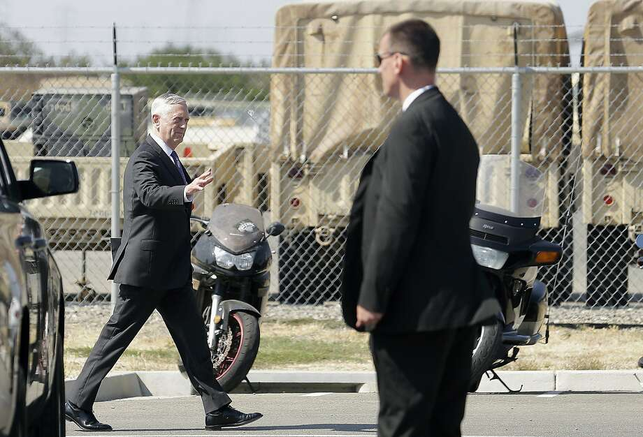 Secretary of Defense Jim Mattis, left, waves as he walks to his vehicle after speaking at the Defense Innovation Unit Experimental in Mountain View on Thursday. In remarks to reporters, Mattis said the United States was prepared to respond to a North Korean attack. Photo: Jeff Chiu, Associated Press