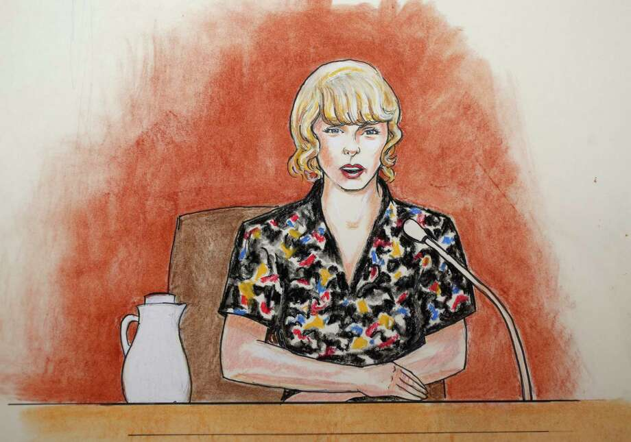 In this courtroom sketch, pop singer Taylor Swift speaks from the witness stand during a trial Thursday, Aug. 10, 2017, in Denver. Swift testified Thursday that David Mueller, a former radio DJ, reached under her skirt and intentionally grabbed her backside during a meet-and-a-greet photo session before a 2013 concert in Denver. (Jeff Kandyba via AP) Photo: Jeff Kandyba, UGCR / Copyright 2017 The Associated Press. All rights reserved.