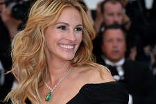 Julia Roberts      Julia Roberts is know to have a the most famous smile in Hollywood, a million dollar smile. Well, turns out it's a $30 million dollar smile. The Oscar winner insured her teeth.