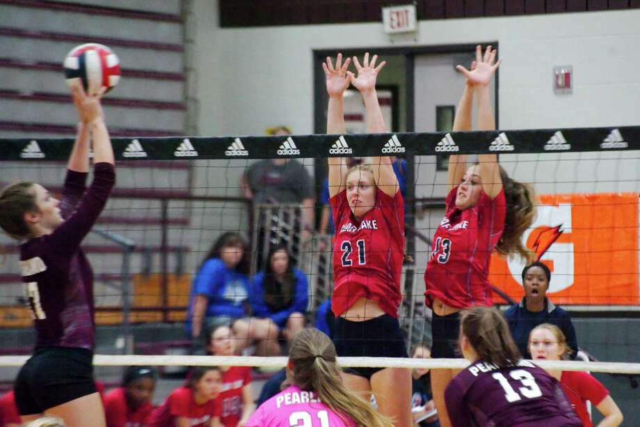 Clear Lake's Theresa McNulty (21) and Clear Lake's Libby Saunders (13) try to block a shot from Pearland's Sarah Wright (17) in the John Turner Classic volleyball tournament at Pearland High School Thursday, Aug. 10. Photo: Kirk Sides / © 2017 Kirk Sides / Houston Chronicle