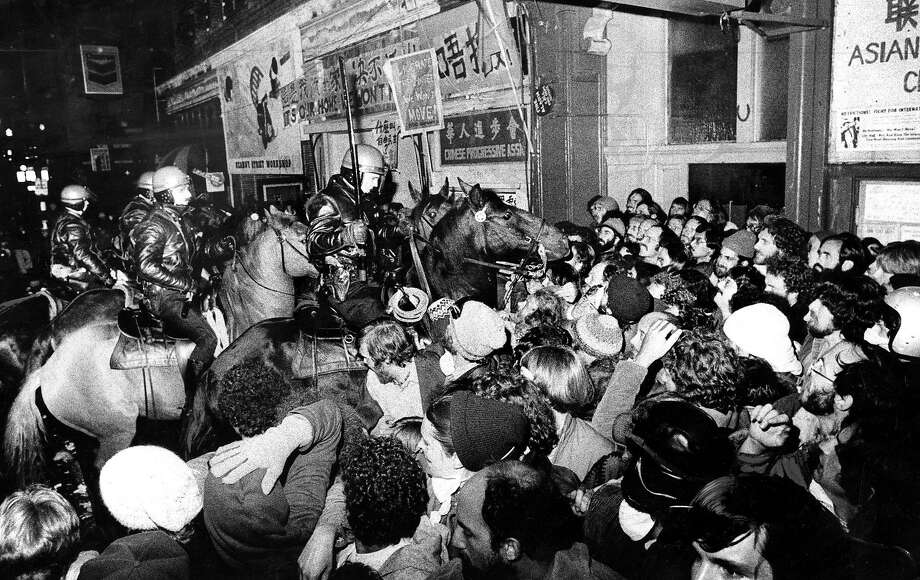Police on horses battle protestors at the International Hotel, the night of the evictions, August 4, 1977 Photo: Stephanie Maze, San Francisco Chronicle