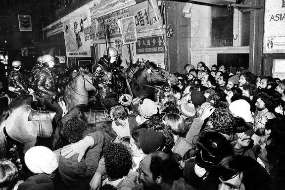 Police on horses battle protestors at the International Hotel, the night of the evictions, August 4, 1977