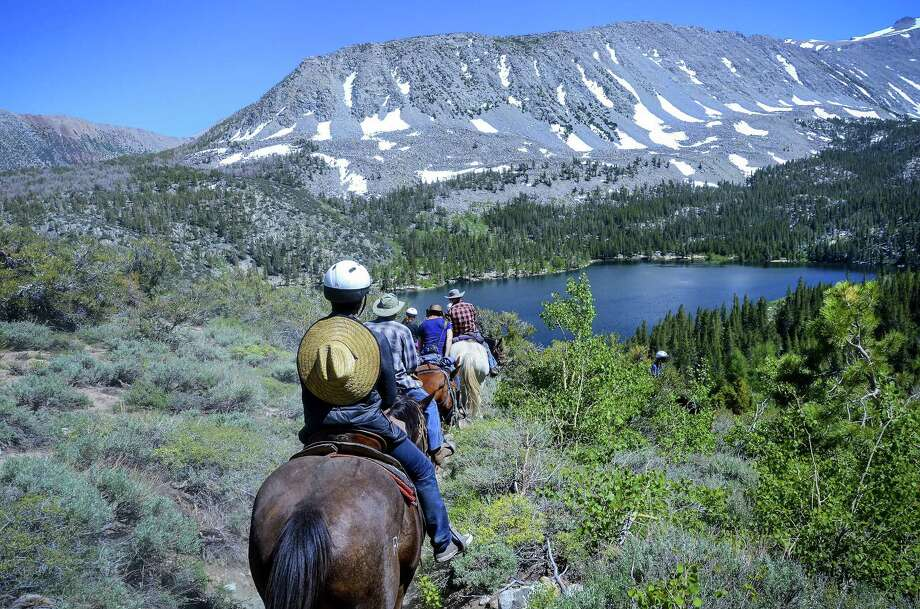 Guests and packers from Rock Creek Pack Station start their ride back to the station from Davis Lake. Photo: Christopher Reynolds /TNS / Los Angeles Times
