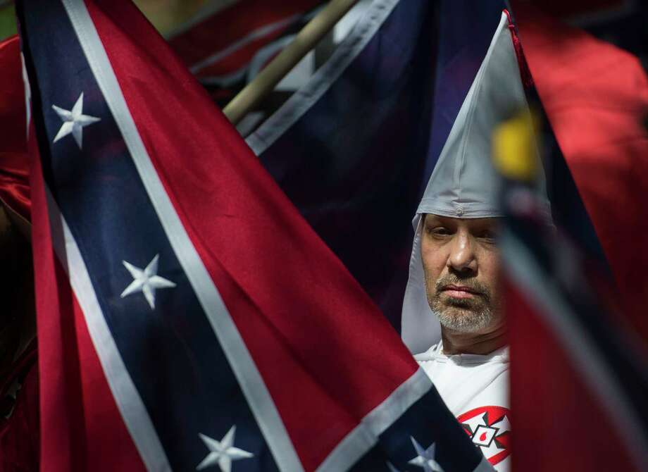 Last month, KKK members and other white nationalists rallied in Charlottesville, Va., calling for the protection of Confederate monuments. A similar rally is planned for Saturday.  Photo: ANDREW CABALLERO-REYNOLDS, Contributor / AFP or licensors