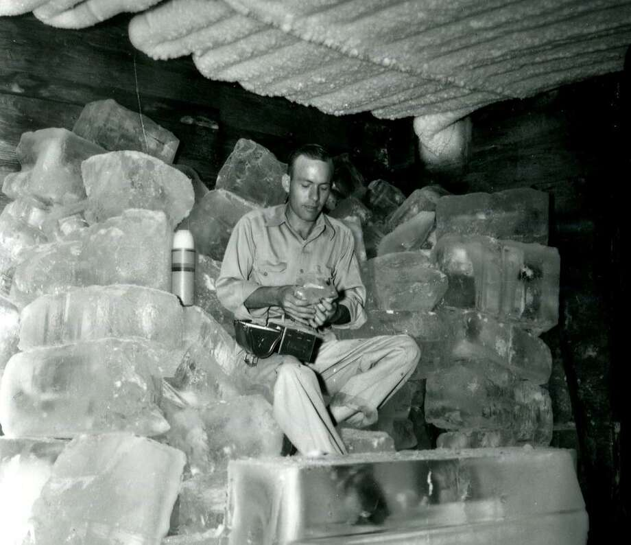 Willie Shannon eats his lunch in an ice house during a heat wave in June 1948. Photo: Courtesy UTSA Special Collections