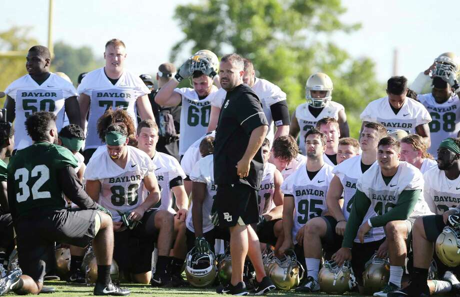 FILE - In this July 27, 2017, file photo, Baylor head football coach Matt Rhule, center, gathers his team in the center of the field following the first day of NCAA college football practice in Waco, Texas. (Rod Aydelotte/Waco Tribune-Herald via AP, File) Photo: Rod Aydelotte, MBO / Waco Tribune-Herald