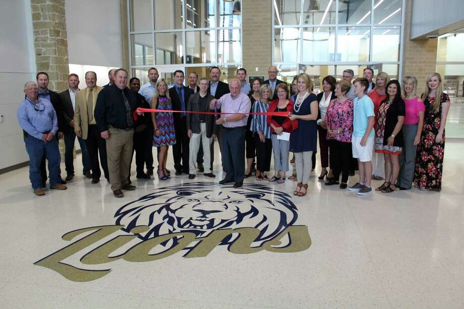 Parents, teachers and school board members perform a ribbon cutting ceremony at the grand opening of Montgomery ISD's two newest schools, Keenan Elementary School and Oak Hills Junior High School, during an open house event Tuesday, Aug. 8, 2017. Photo: Jay R. Jordan