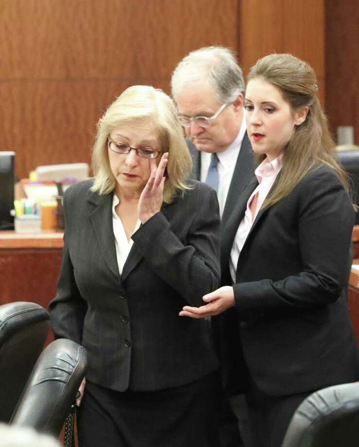 Sandra Melgar, left, a 57-year-old widow accused of killing her husband in 2012 and trying to cover it up, listens to opening arguments. Photo: Steve Gonzales, Melgar0809 / 2017
