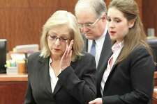 Sandra Melgar, left, a 57-year-old widow accused of killing her husband in 2012 and trying to cover it up, listens to opening arguments.