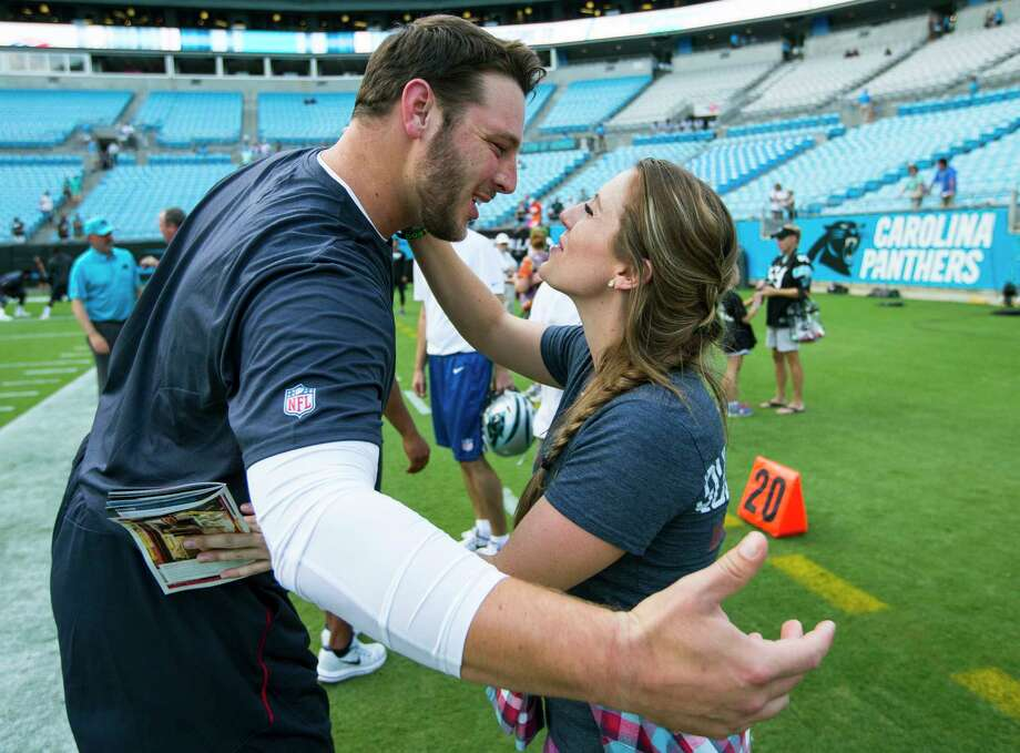 Texans offensive guard David Quessenberry embraces his girlfriend, Maegan Cruse, as she surprises him on the field Wednesday before his return to game action. Photo: Brett Coomer, Staff / © 2017 Houston Chronicle}