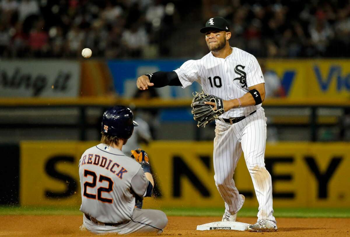CHICAGO, IL - AUGUST 10: Yoan Moncada #10 of the Chicago White Sox throws to first base after forcing out Josh Reddick #22 of the Houston Astros during the sixth inning at Guaranteed Rate Field on August 10, 2017 in Chicago, Illinois. (Photo by Jon Durr/Getty Images)