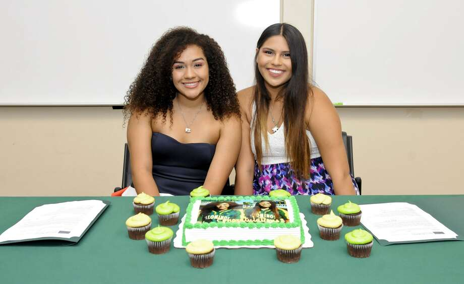 Laredo Community College's Karina Moreno, left, and Leslie Reyes signed their national letters of intent to continue their softball careers at Eastern New Mexico University. Photo: Danny Zaragoza /Laredo Morning Times / Laredo Morning Times